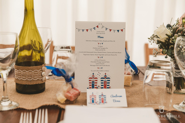 beach hut wedding table stationery