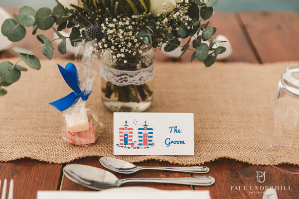 beach hut wedding table stationery